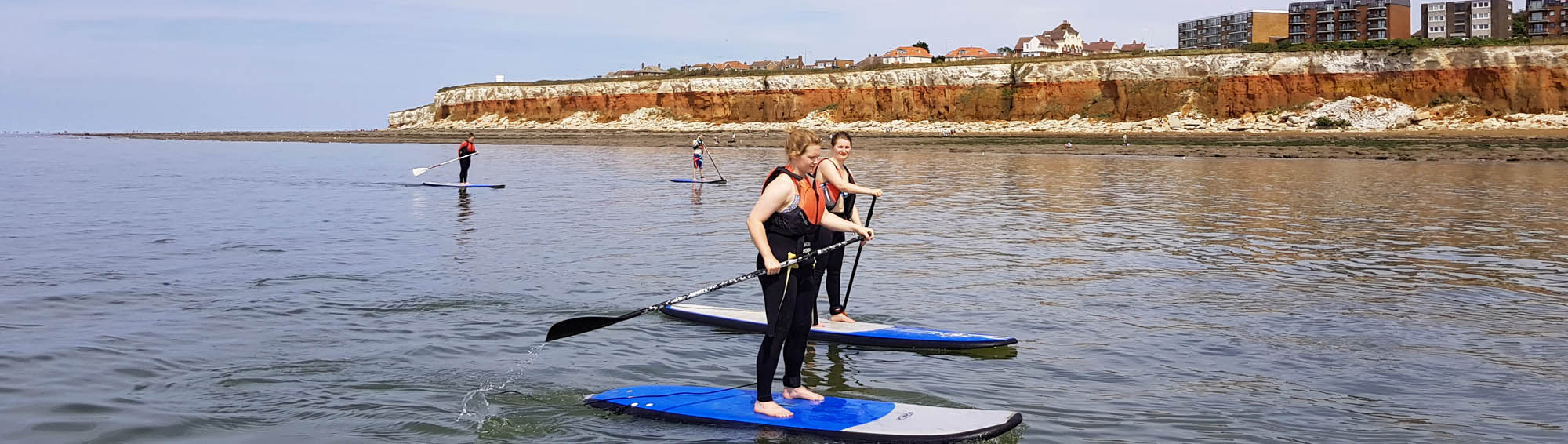 Paddleboarding by Hunstanton Cliffs